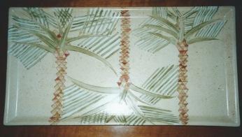 3 palmiers sur fond moucheté couleur sable